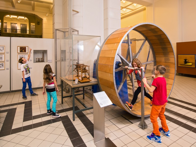 "Children try out the hands-on object ""hamster wheel"" which can be used to generate energy. To be seen in the exhibition ""Energy"""